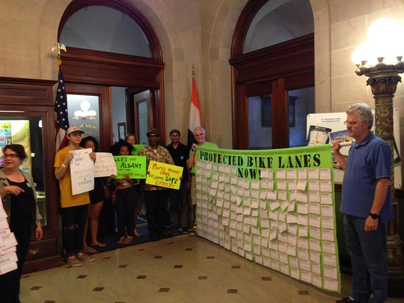 activists delivered about 250 postcards to Mayor Kathy Sheehan from residents, business owners and visitors who want protected bicycle lanes on Madison Avenue.