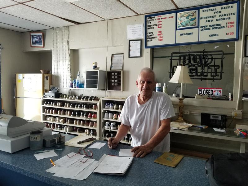 George Aslan behind the counter at Candle Lanes in Pittsfield, Massachusetts.