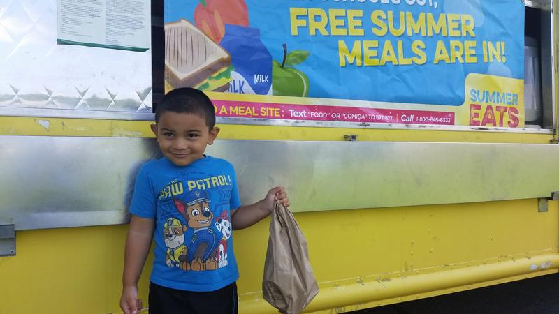 Javier Cruz, age 4, was happy to get his lunch from the BabyBerk food truck at the Colonial Village Apartments