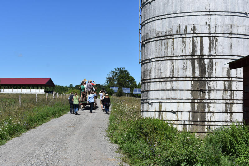 Rolling past a silo to the poultry barn