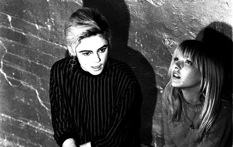 Bibbe Hansen (right) & Edie Sedgwick on the set of Andy Warhol's 1965 film, 'Prison'. – photo by Billy Name