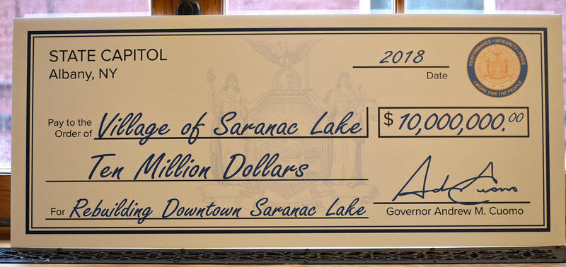 Large check handed to Saranac Lake officials by Governor Cuomo