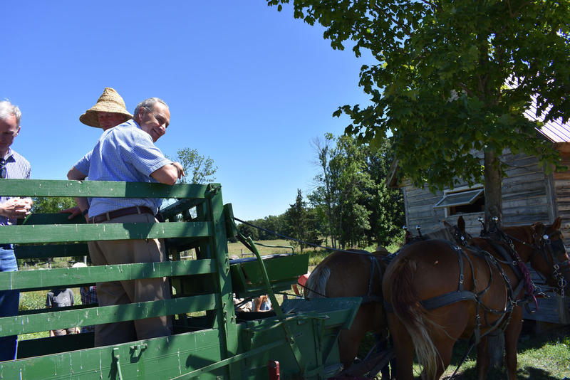 Senator Charles Schumer tours the Essex Farm on a hay wagon