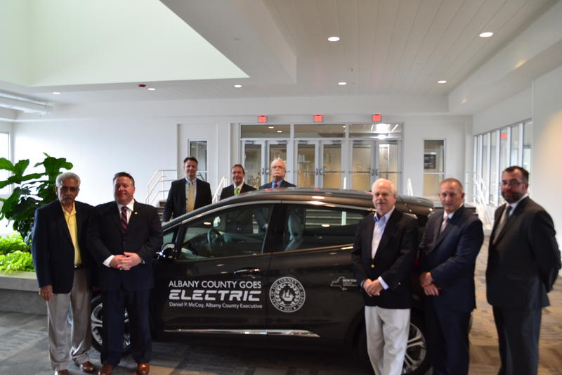 nd other officials with new electric cars at Albany TU Center.