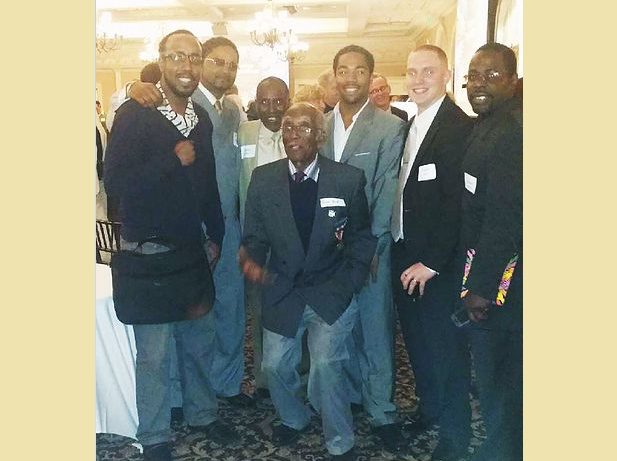 Ralph Boyd Sr. (center) poses with members of Community Fathers Incorporated.
