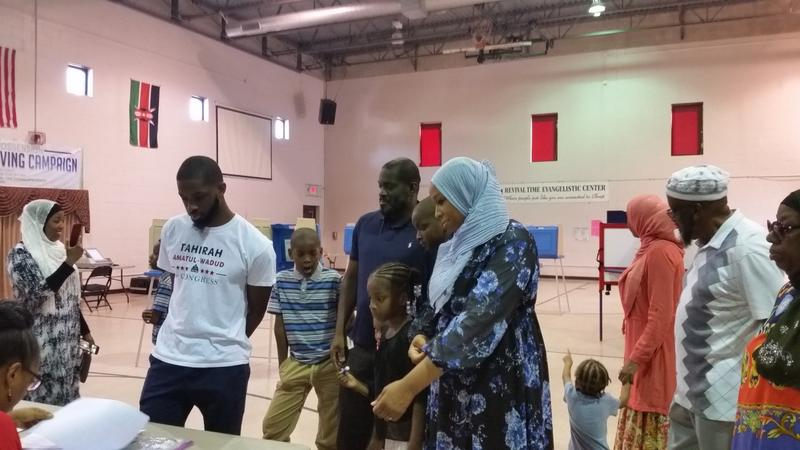 Tahirah Amatul-Wadud, who is challenging incumbent Congressman Richard Neal in Tuesday's primary arrived at the polling place at the JC Williams Communty Center with family and friends