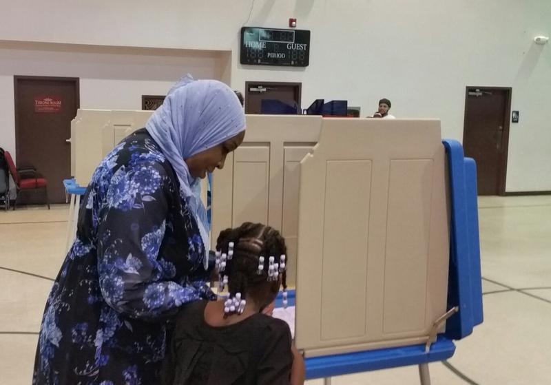 Amatul-Wadud brought her daughter Mahmooda Bey to the voting booth to see her mother's name on the ballot.