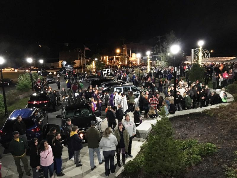 Over 1,000 people jammed a riverside park in Amsterdam, New York, for Monday night's vigil.