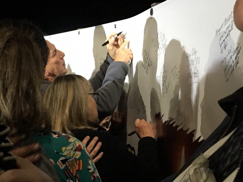 The tribute ended with family and friends lining up to sign and leave messages on a large