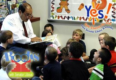 Sen. Tom Libous reading to children.