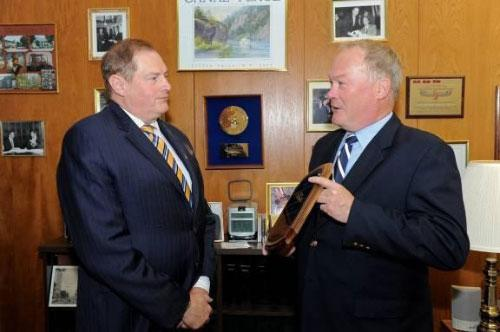 Assemblyman Marc W. Butler (R,C,I-Newport) is presented with the New York State Rifle and Pistol Association's 2011 Legislator of the Year Award by its President, Tom King.