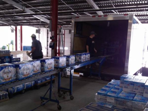 Employees of Plattsburgh Distributing load truck