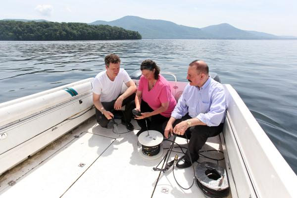IBM Research Scientist Harry Kolar (right), Sandra Nierzwicki-Bauer of the RPI Darrin Fresh Water Institute (center) and Eric Siy from The FUND to Save Lake George scout locations for new sensors.