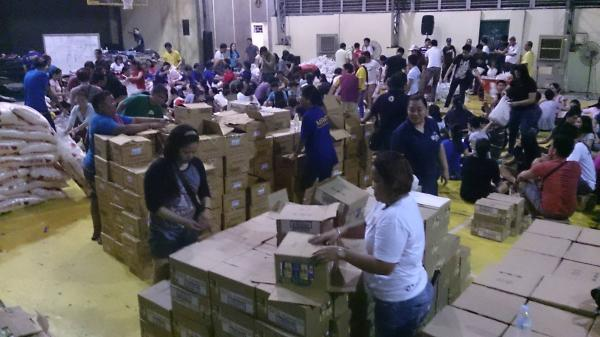 Food has arrived and is being readied to hand out to storm victims at a distribution center near Tacloban City.