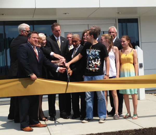 NY Lt. Gov. Bob Duffy and CNSE's Dr. Alain Kaloyeros are flanked by government officials and students as they cut the ribbon for the new Tech Valley High School on the CNSE campus. (August 20, 2014)