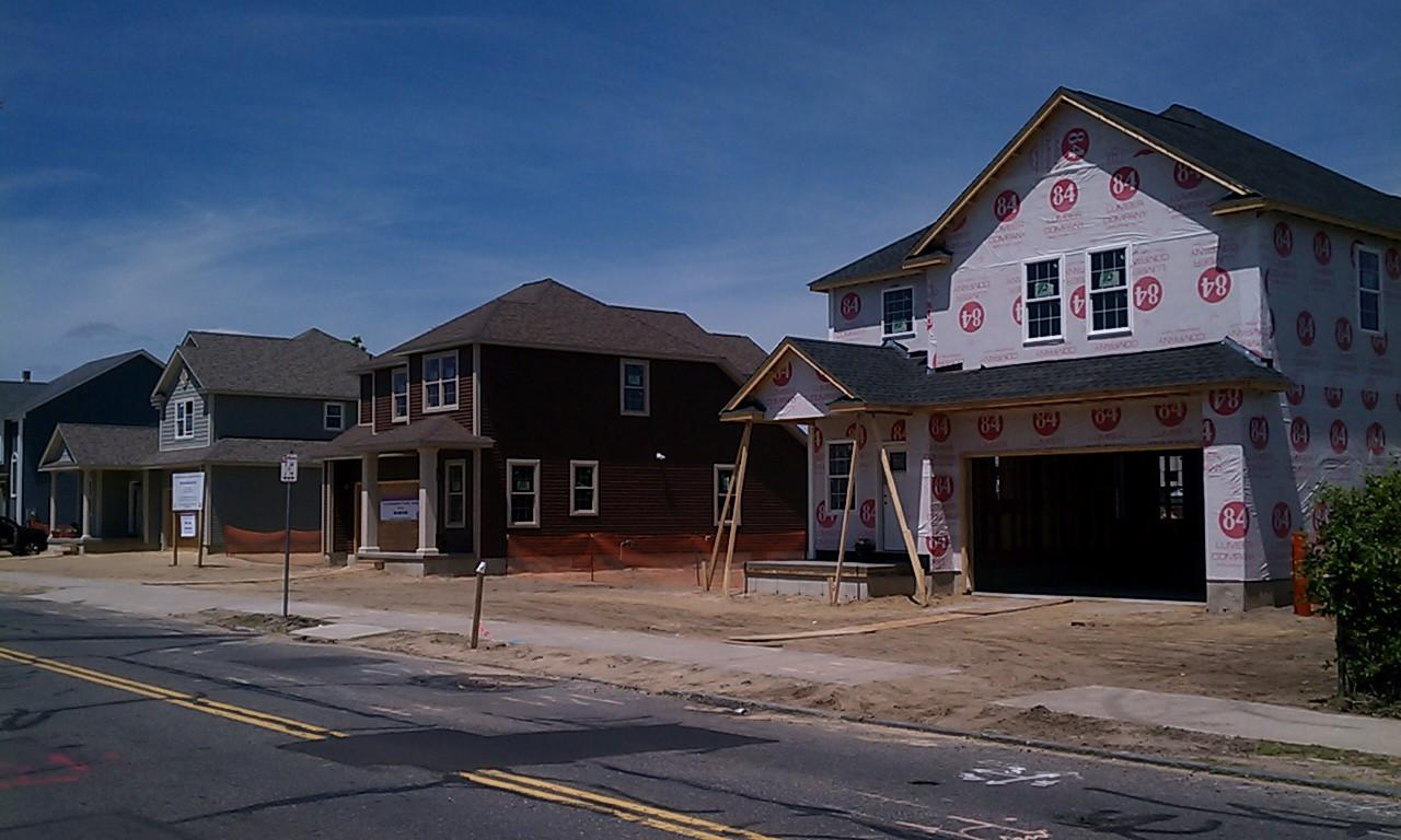 New houses going up in neighborhood slammed by 2011 for Building a house in ma