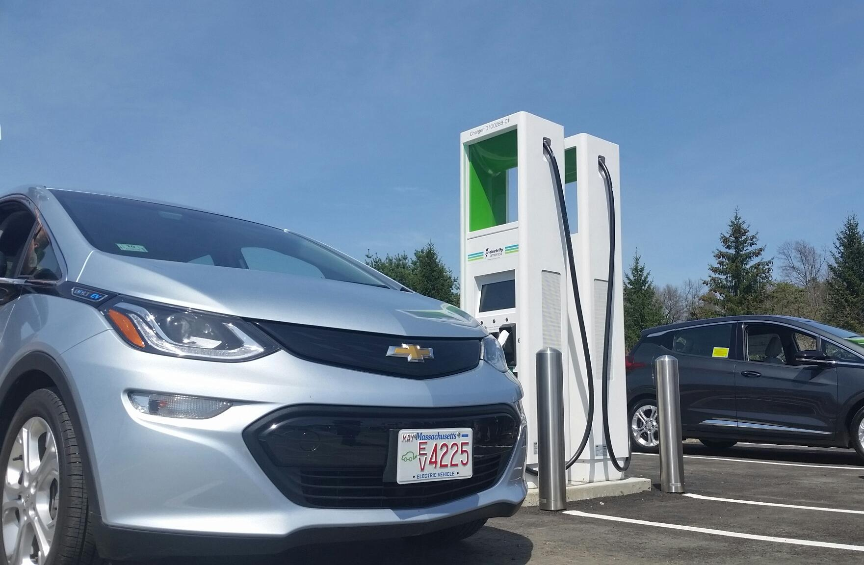 The Electrify America electric vehicle charging station, the first of its kind in the nation, is located in a shopping plaza on Memorial Drive in Chicopee, ...