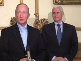 Governor Mitch Daniels (left) and Governor-Elect Mike Pence meet to discuss a transition plan.