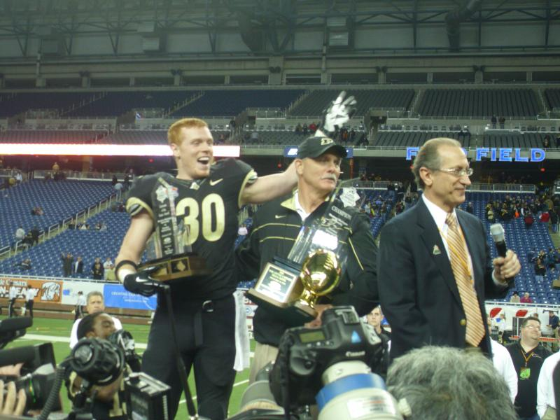 Joe Holland and Danny Hope celebrate Purdue's first bowl victory in four years