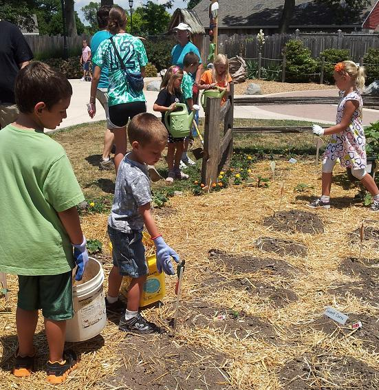 Children at the McAllister Center Day Camp plant a vegetable garden at Columbian Park Zoo in Lafayette.