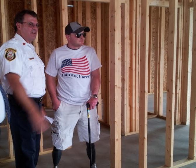 Matt Bowman and Lafayette Fire Chief Richard Doyle tour Bowman's new home.