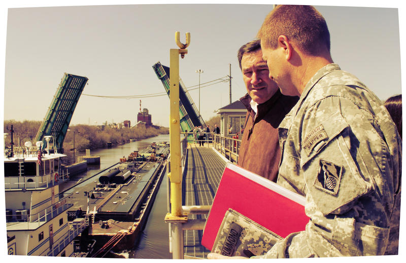 Col. Frederic A. Drummond Jr., Chicago District commander, speaks to Sen. Joe Donnelly during a Congressional Staff tour at Brandon Road Lock and Dam, Joliet, Ill., April 22, 2014.