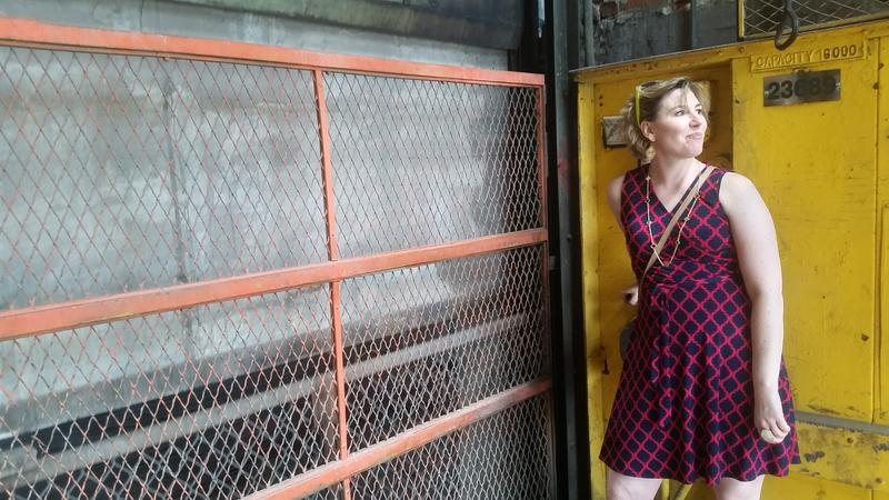 Community organizer Willow Wetherall operates the Studebaker freight elevator to reach the roof.