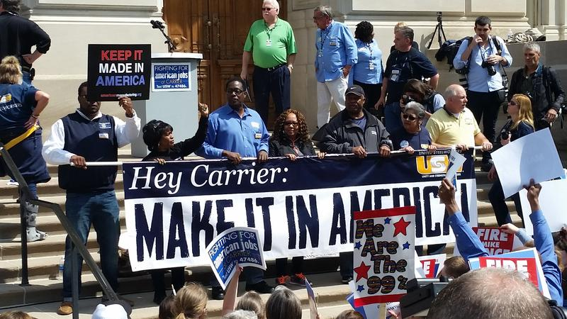 Employees who will lose their jobs at the Indianapolis Carrier factory stood at the front of Friday's rally with union members and Bernie Sanders supporters.