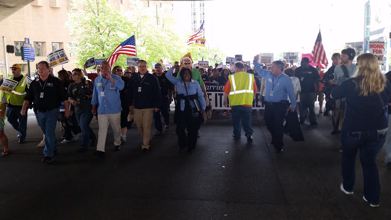 AFL-CIO president Richard Trumka, at right, marches with laid-off Carrier workers through downtown Indianapolis.