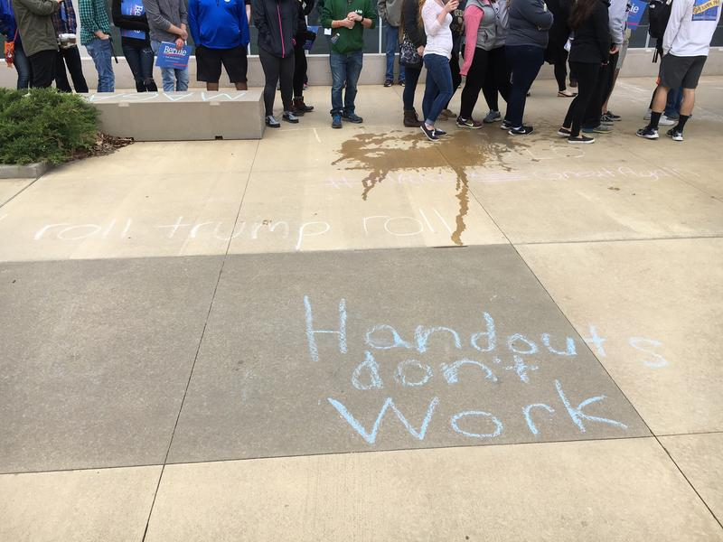 Trump chalk graffitti decorates the sidewalks in front of the Purdue Rec.