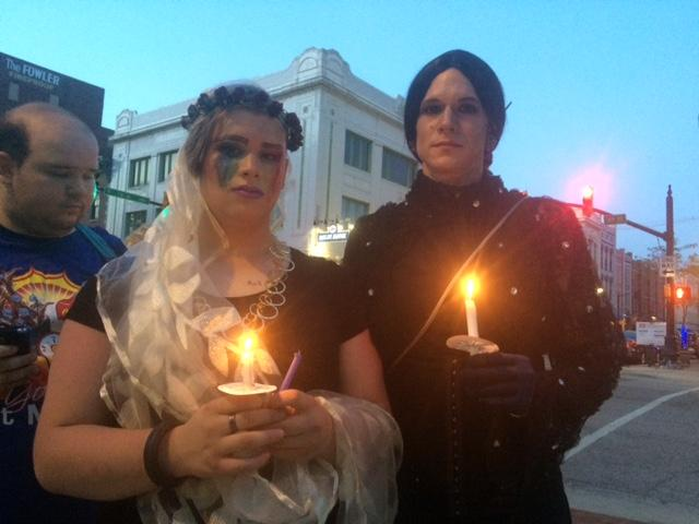 Two attendees hold candles at Monday's tribute to those killed in an Orlando nightclub over the weekend