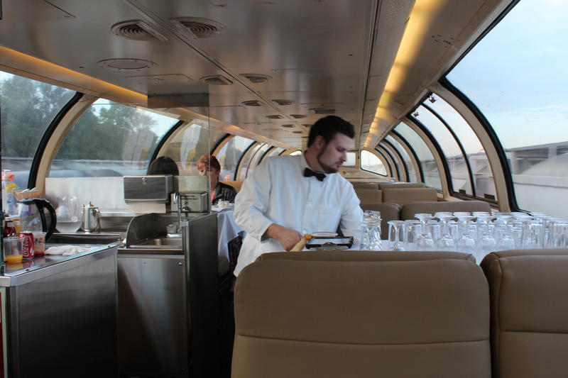 Steward Matt Dockham serves business class passengers in the train's dome car between Lafayette and Rensselear.