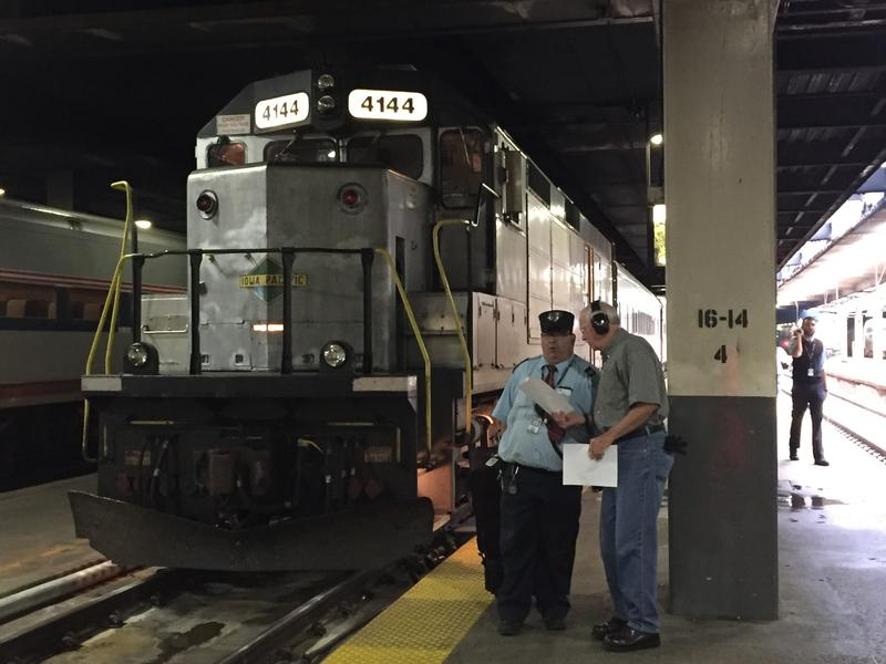 Amtrak Conductor Mark Slaughter deboards the Hoosier State at Chicago Union Station August 19, 2016.