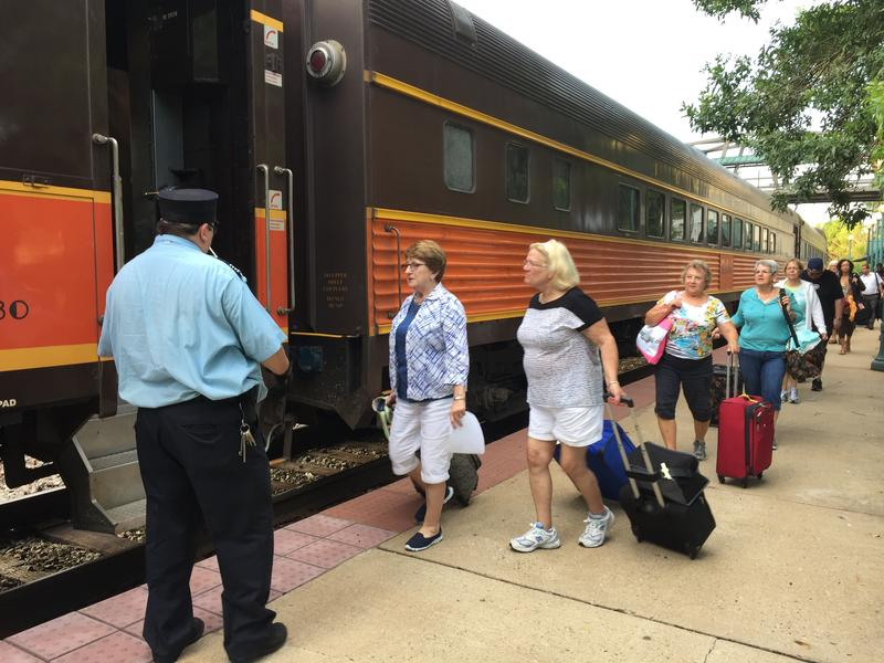 Passengers board the Hoosier State train Friday, August 19, 2016