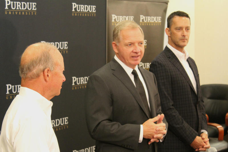 Bobinski (center) is introduced Tuesday by Purdue President Mitch Daniels (left) and Purdue Trustees Chairman Michael Berghoff (right).