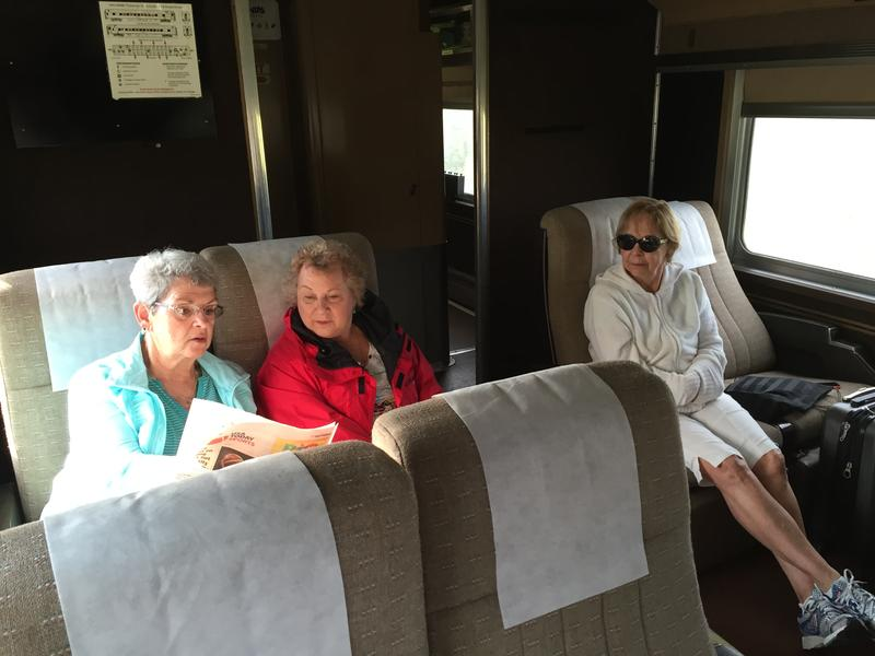 High school friends Sara Johnston and Diana Marion talk while riding the Hoosier State train August 19, 2016.