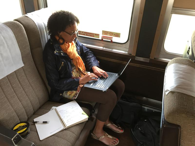 Tasha Zephirin, a doctoral student at Purdue University, uses the WIFI on board the Hoosier State train August 19, 2016.
