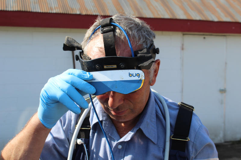 Tom Troxel dons a pair of goggles that will help him conduct ultrasounds on dairy cows.