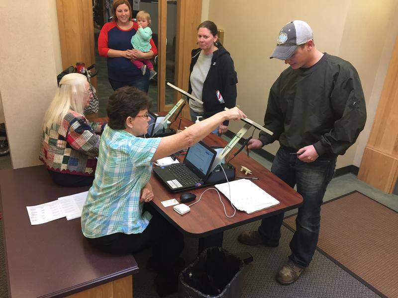 Voters register to cast a ballot at the Tippecanoe County office building on Monday, Nov. 7, 2016.