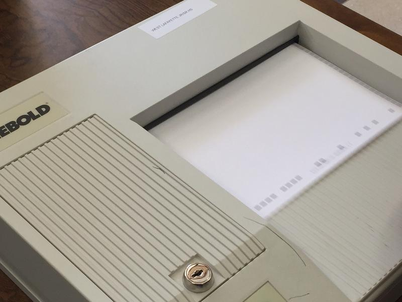 A scanner tallies a paper ballot in the West Lafayette school tax referendum.