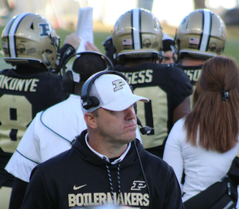 Purdue coach Jeff Brohm checks the score in the 4th quarter as IU closes the gap.