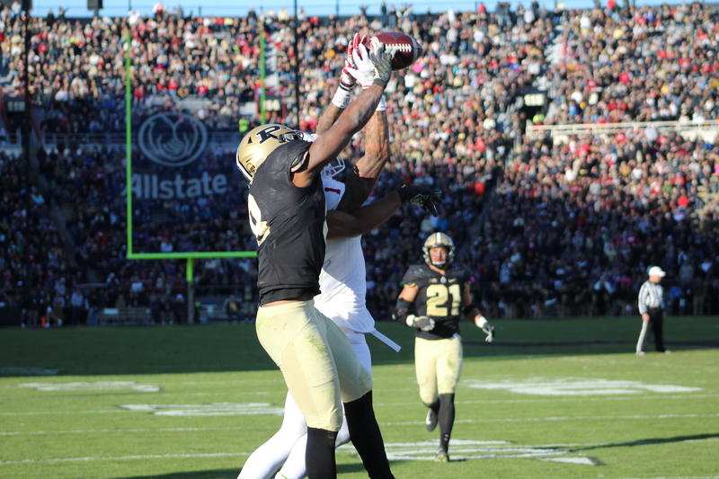Purdue defensive back Josh Okonye knocks a potential touchdown catch away from IU wideout Simmie Cobbs in the game's final minutes.