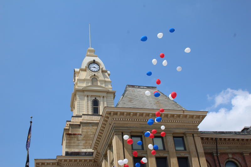 Balloons fly overhead during the Kirtley Tower dedication ceremony.