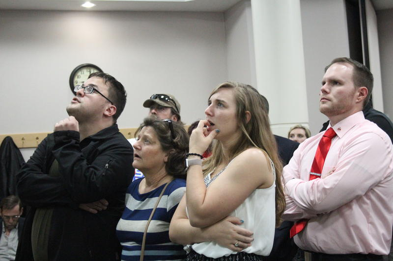 Voters watch election results roll in Tuesday night at the Tippecanoe County Building.