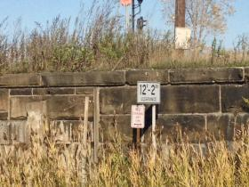 Sign near William and Metcalfe CSX railroad bridge indicates 12-foot clearance