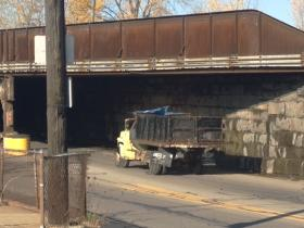 Truck clears the CSX railroad bridge built in 1926 at William and Metcalfe in Buffalo