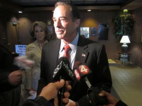 Chris Collins talks with reporters after voting in Clarence Tuesday