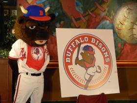Team mascot Buster T. Bison shows off the club's new primary logo.