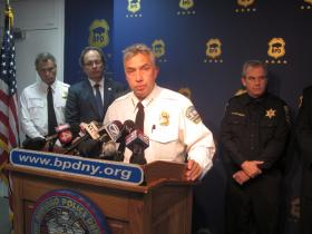 Police Commissioner Daniel Derenda, with U.S Attorney William Hochul in the background, details the arrest of George Torres.