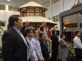 Employees and local leaders gather inside Rich Products atrium for investment announcement